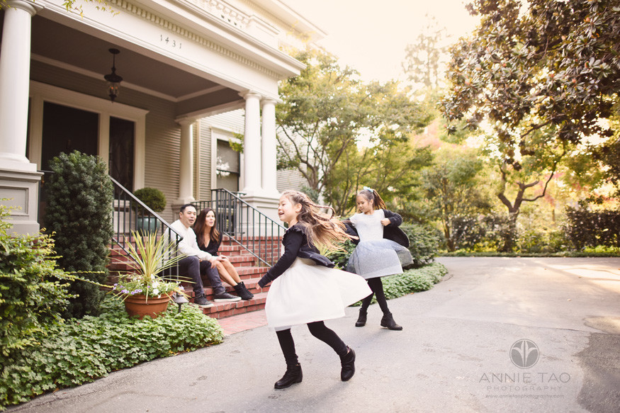 San-Francisco-lifestyle-family-photography-young-daughters-twirling-while-parents-watch