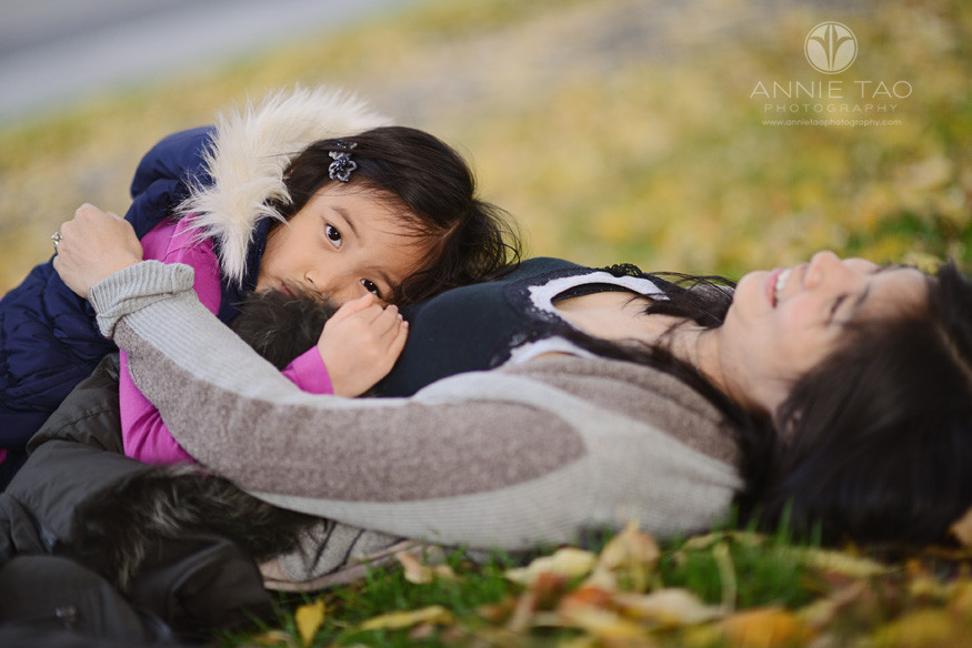 Bay-Area-Palo-Alto-lifestyle-family-photography-young-girl-laying-quietly-on-mom