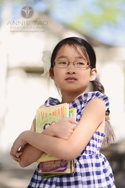 East-Bay-San-Francisco-children-photography-school-themed-styled-shoot-girl-holding-books-closeup