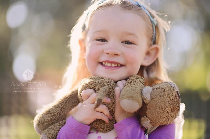 bay-area-lifestyle-children-photography-blonde-preschooler-holding-lovey-in-sunshine