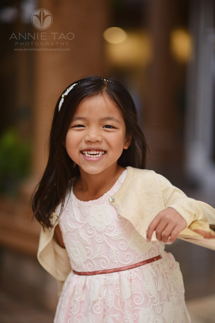 East-Bay-lifestyle-children-photography-young-girl-leaning-on-gold-rail