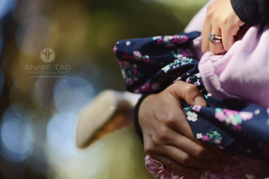 East-Bay-lifestyle-photography-womans-hand-with-bling-holding-sleeping-baby