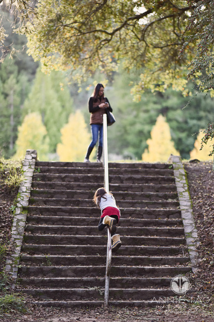 east-bay-berkeley-lifestyle-children-photography-girl-climbing-stairs-rail-while-mom-at-top