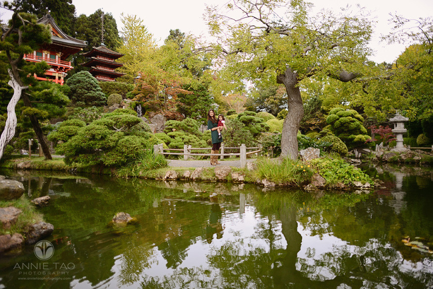 San-Francisco-lifestyle-family-photography-woman-holding-toddler-daughter-in-Japanese-garden