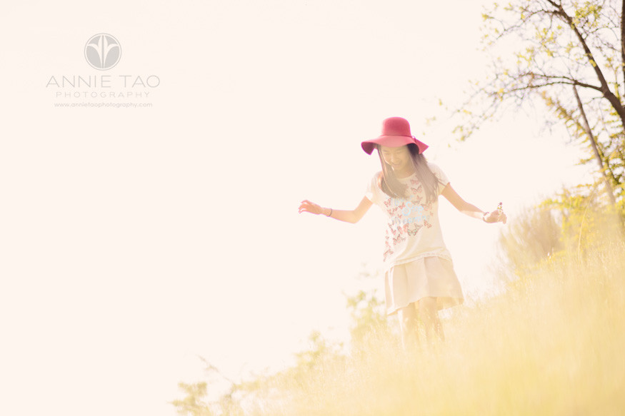 east-bay-lifestyle-children-photography-girl-in-hat-trekking-downhill