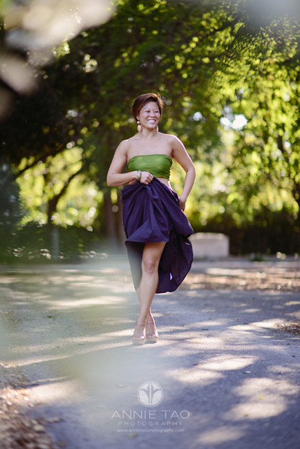 East-Bay-styled-photography-woman-with-short-hair-playing-with-full-skirt