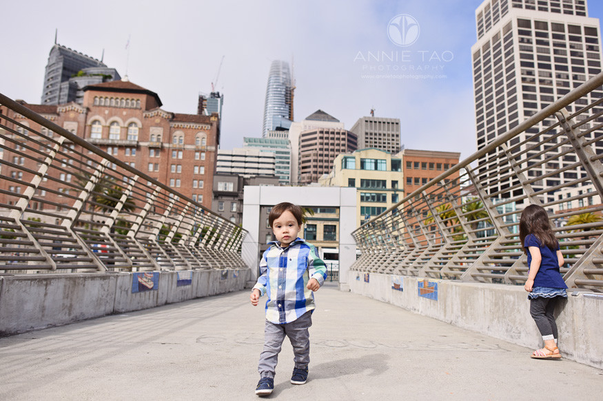 San-Francisco-lifestyle-children-photography-sister-walking-through-toddler-brother-on-pier