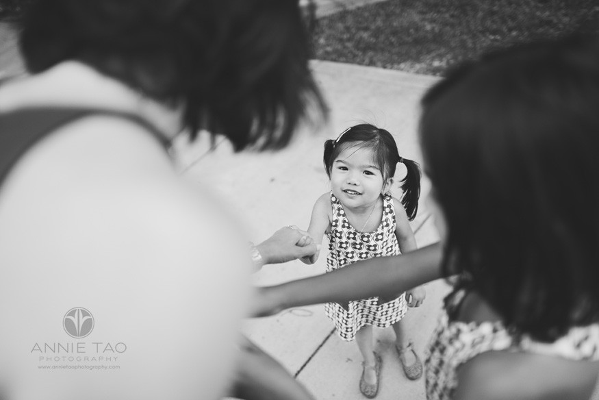 East-Bay-lifestyle-children-photography-toddler-holding-moms-hand-and-looking-up-BxW