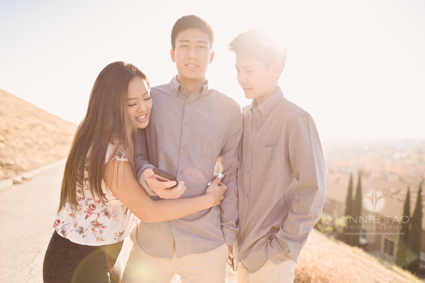South-Bay-lifestyle-teen-young-adult-photography-siblings-hugging-with-sunflare