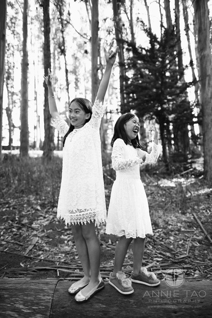 San-Francisco-lifestyle-children-photography-sisters-playing-air-guitar-in-woods-BxW