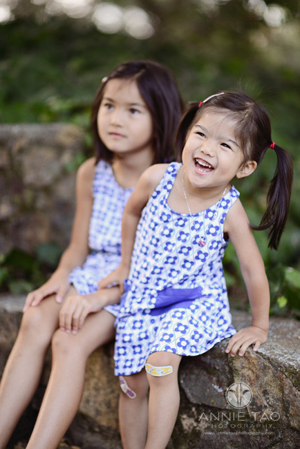 East-Bay-lifestyle-children-photography-toddler-girl-laughing-while-climbing-up-to-sit-with-sister
