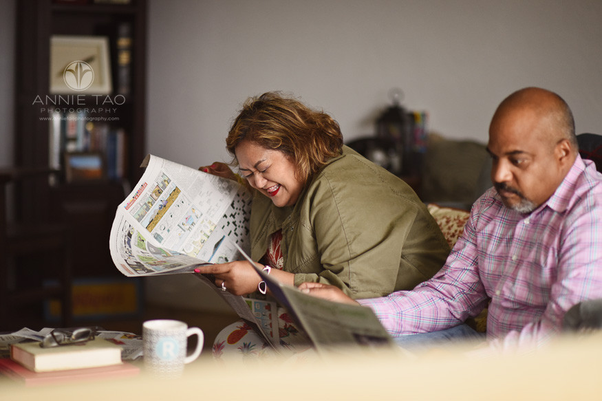East-Bay-styled-photography-woman-laughing-with-funnies-newspaper-section-in-livingroom