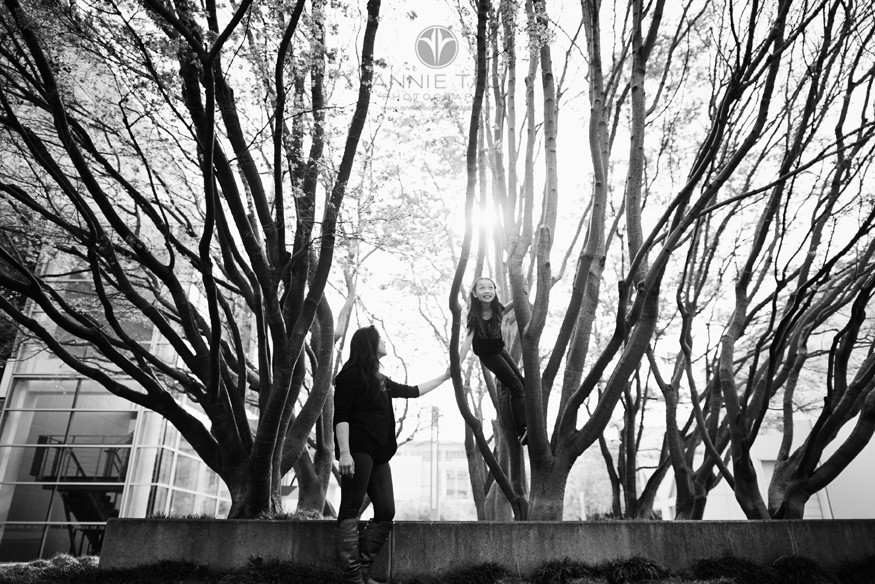 San-Francisco-lifestyle-family-photography-mother-helping-daughter-in-windy-tree-maze-BxW