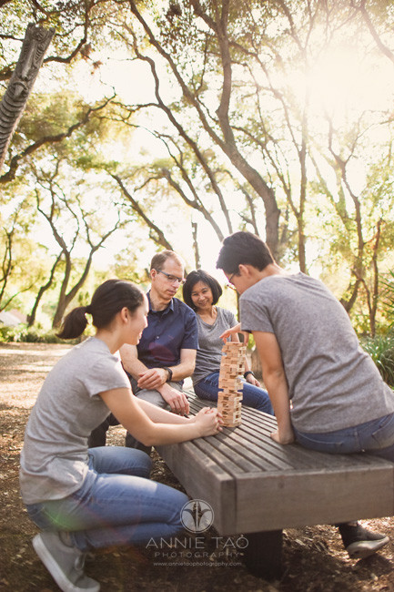 Bay-Area-lifestyle-family-teen-photography-serious-about-Jenga-in-statue-garden-3