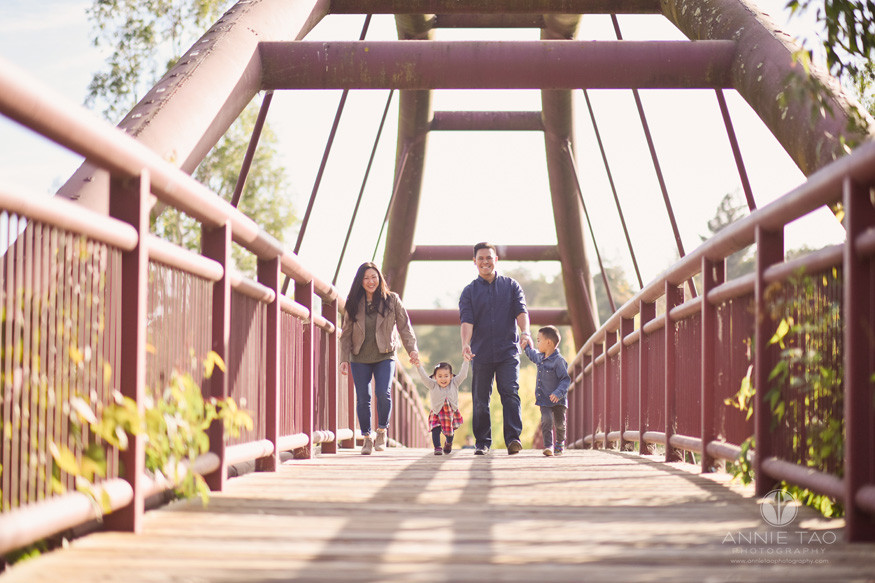 South-Bay-lifestyle-family-photography-holding-hands-while-walking-across-red-bridge