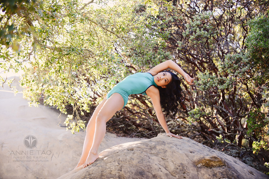 East-Bay-dance-photography-dancer-posing-between-rock-and-trees