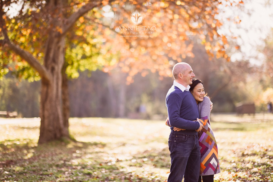South-Bay-lifestyle-couple-photography-hugging-by-large-autumn-tree-of-colorful-leaves