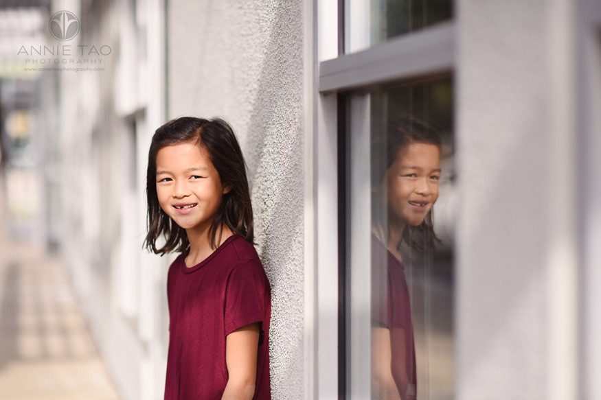 South-Bay-commercial-photography-girl-near-window-reflection-outside-coding-school