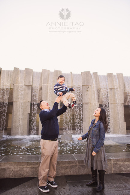 san-francisco-lifestyle-family-photography-father-throwing-toddler-into-air-in-city