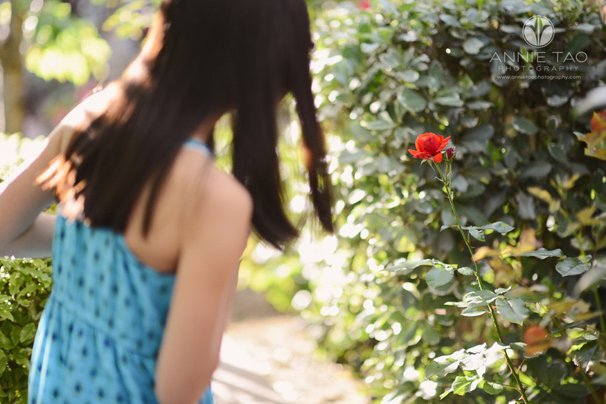 East-Bay-lifestyle-preteen-photography-girl-looking-carefully-among-bushes