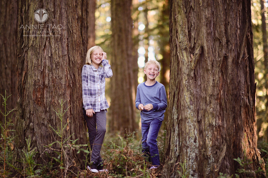 east-bay-lifestyle-children-photography-boy-and-girl-in-woods-cracking-up