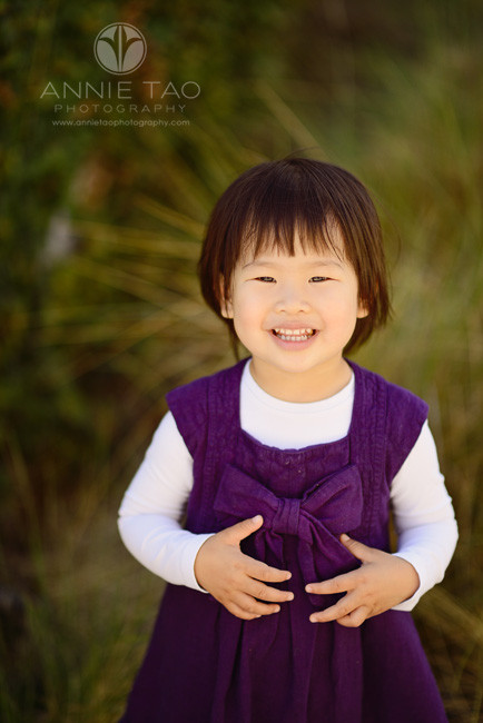 San-Francisco-lifestyle-children-photography-toddler-smiling-in-purple-dress