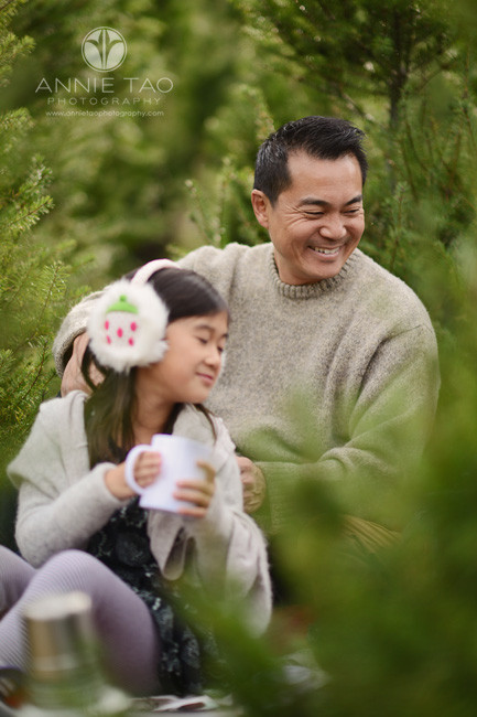 bay-area-lifestyle-photography-man-gleeful-while-sitting-with-family-in-tree-farm