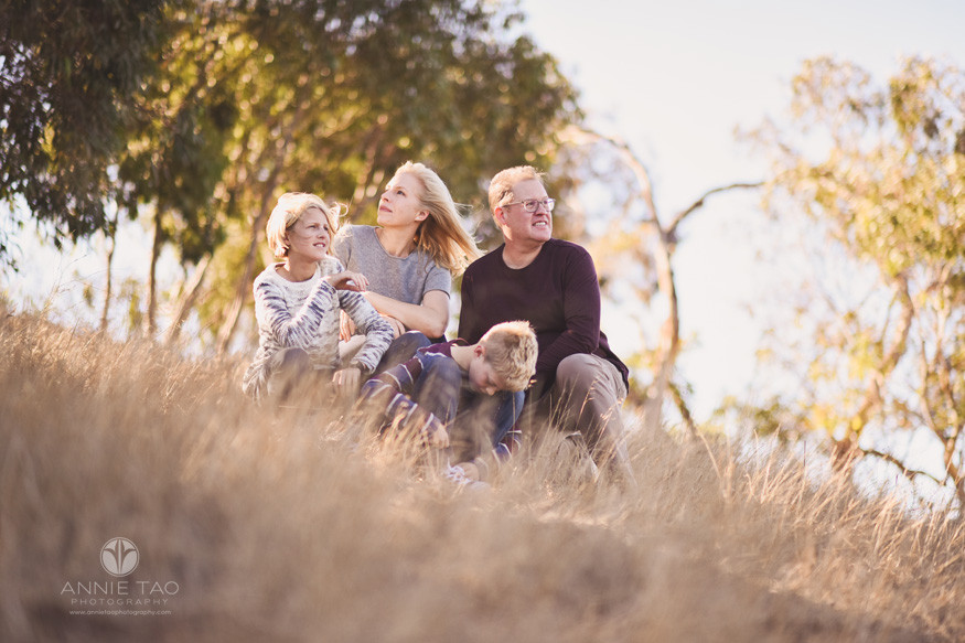South-Bay-lifestyle-family-photography-squatting-on-dried-grassy-hill-on-windy-day