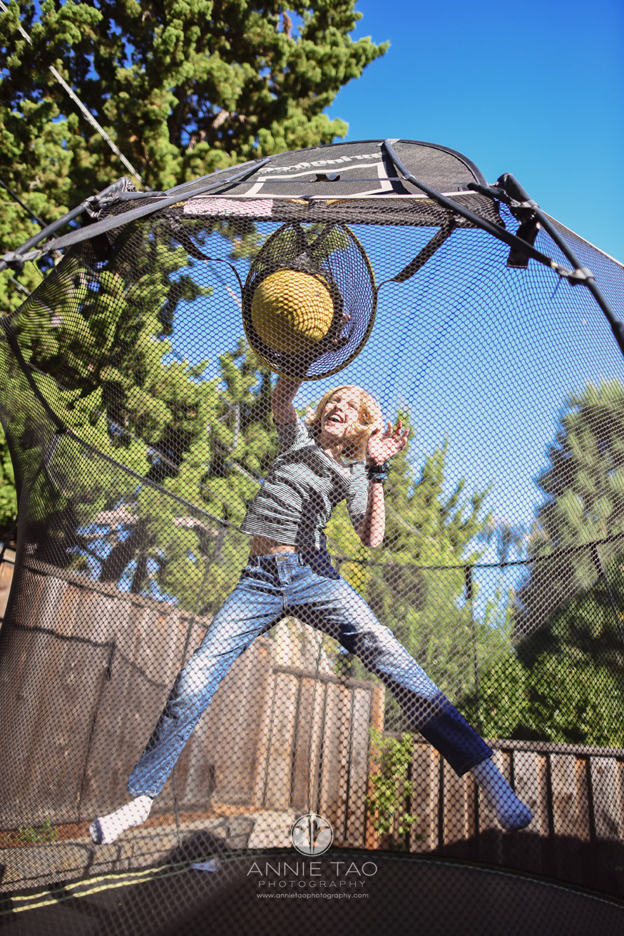 Bay-Area-lifestyle-children-photography-girl-dunking-a-basketball-on-a-trampoline-LG