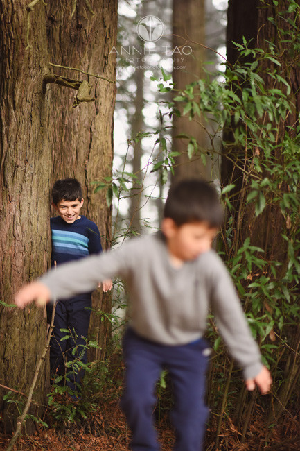 East-Bay-lifestyle-children-photography-boy-standing-behind-younger-brother-in-forest