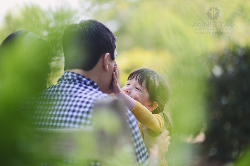 Bay-Area-lifestyle-family-photography-young-girl-touching-fathers-face-view-through-leaves