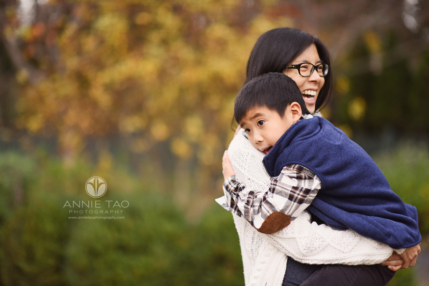 Bay-Area-lifestyle-family-photography-laughing-woman-carrying-young-son-in-arms