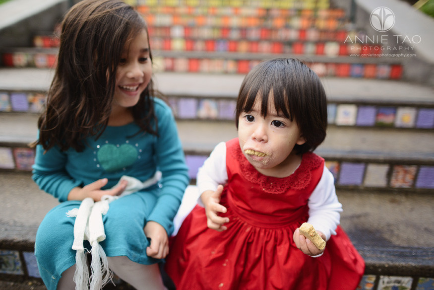 San-Francisco-lifestyle-children-photography-sisters-eating-cookies-on-mosaic-stairs