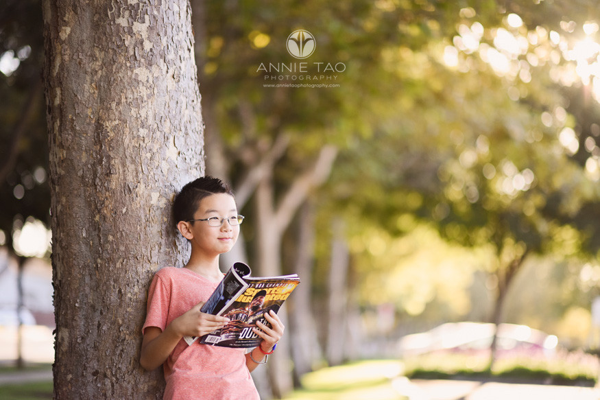 East-Bay-lifestyle-children-photography-boy-reading-about-golden-state-warriors