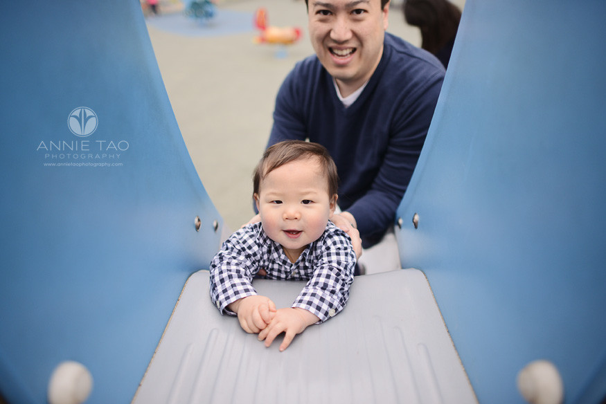 San-Francisco-lifestyle-baby-photography-man-chilling-out-with-baby-on-blue-slide