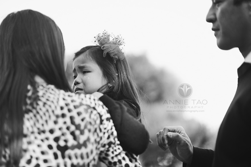East-Bay-lifestyle-family-photography-mom-and-dad-consoling-their-crying-daughter-BxW