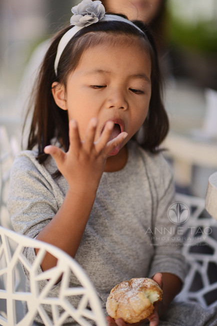 San-Francisco-lifestyle-children-photography-young-girl-licking-fingers-with-pastry