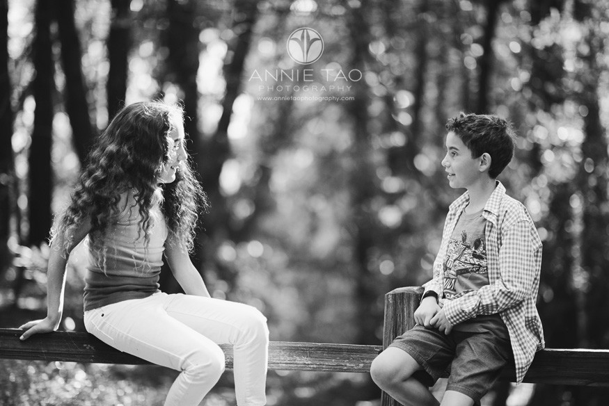 East-Bay-lifestyle-family-photography-brother-and-sister-looking-at-each-other-in-the-woods