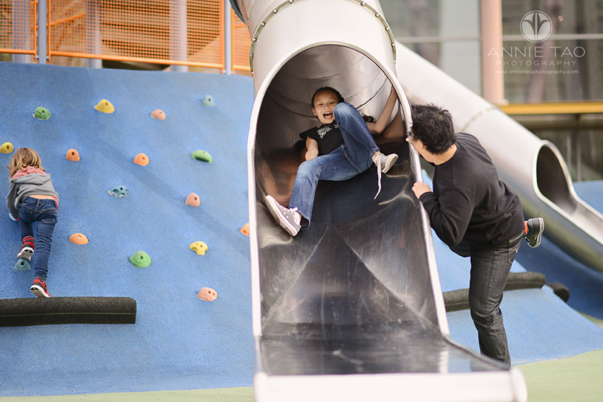 San-Francisco-lifestyle-family-photography-woman-scaring-girl-coming-down-slide