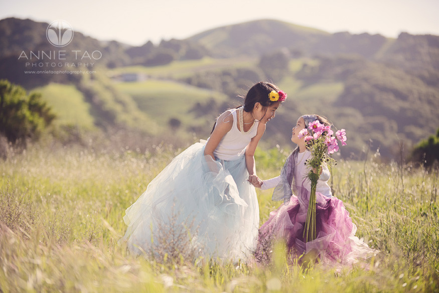 East-Bay-styled-children-photography-sisters-holding-hands-and-looking-at-each-other