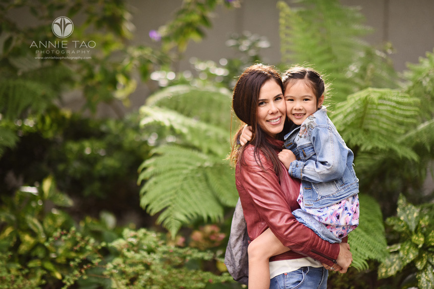 San-Francisco-lifestyle-family-photography-woman-carrying-her-daughter-by-urban-garden