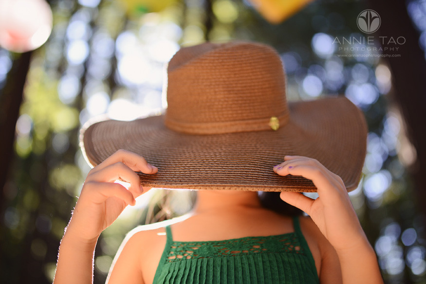 East-Bay-styled-children-photography-young-girl-hiding-under-hat