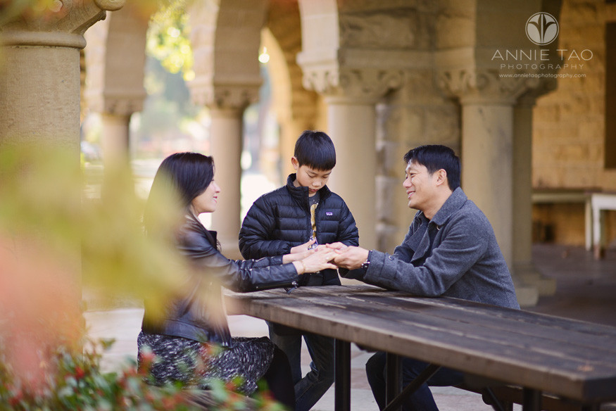 Bay-Area-Palo-Alto-family-photography-parents-holding-hands-while-son-shuffles-cards