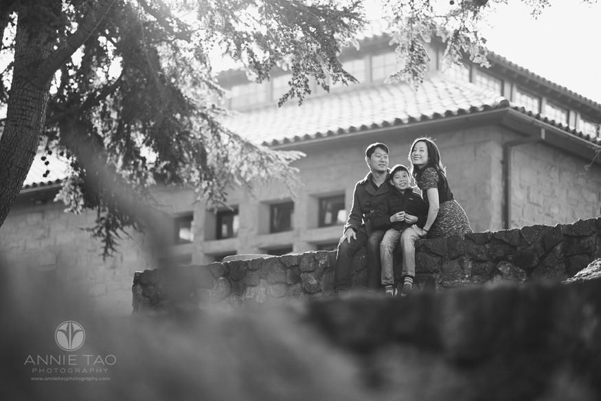 Bay-Area-Palo-Alto-family-photography-family-sitting-on-rock-wall-BxW