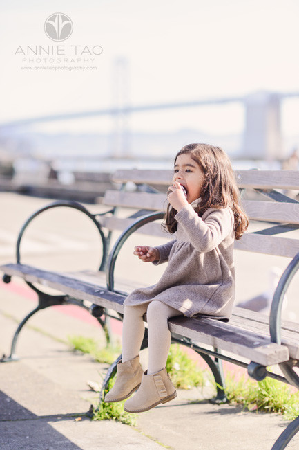 san-francisco-lifestyle-children-photography-preschooler-girl-devouring-cupcake-at-ferry-plaza