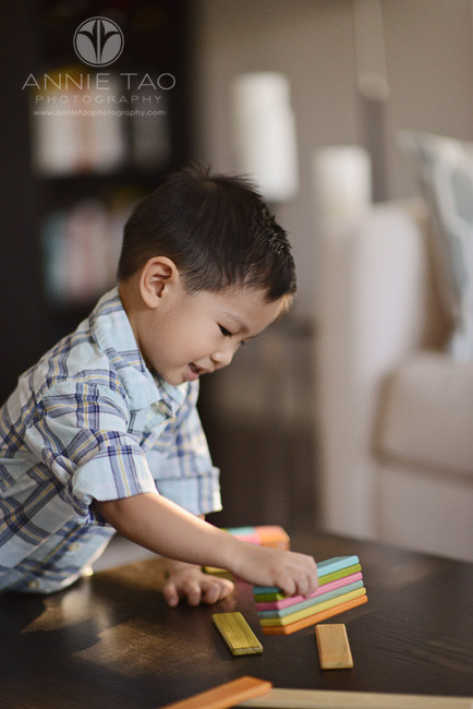 South-Bay-lifestyle-children-photography-toddler-boy-plays-with-wooden-toy
