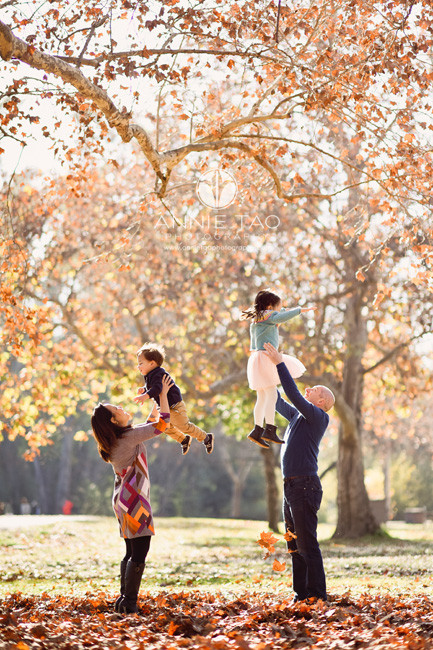 South-Bay-lifestyle-family-photography-parents-throwing-kids-up-in-air-by-colorful-leaves
