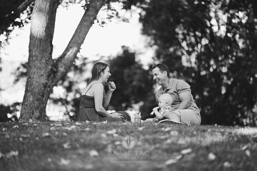 East-Bay-lifestyle-family-photography-parents-laughing-while-picnicking-with-baby-BxW