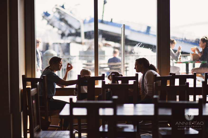 San-Francisco-lifestyle-family-photography-family-eating-donuts-by-window-silhouette
