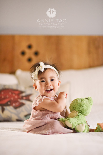 South-Bay-lifestyle-photography-baby-girl-laughing-on-bed